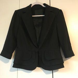 Beautiful Bebe black blazer size 10 peplum
